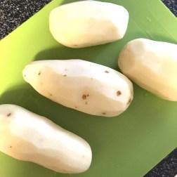 Beautifully peeled potatoes, courtesy of Liz and Jason