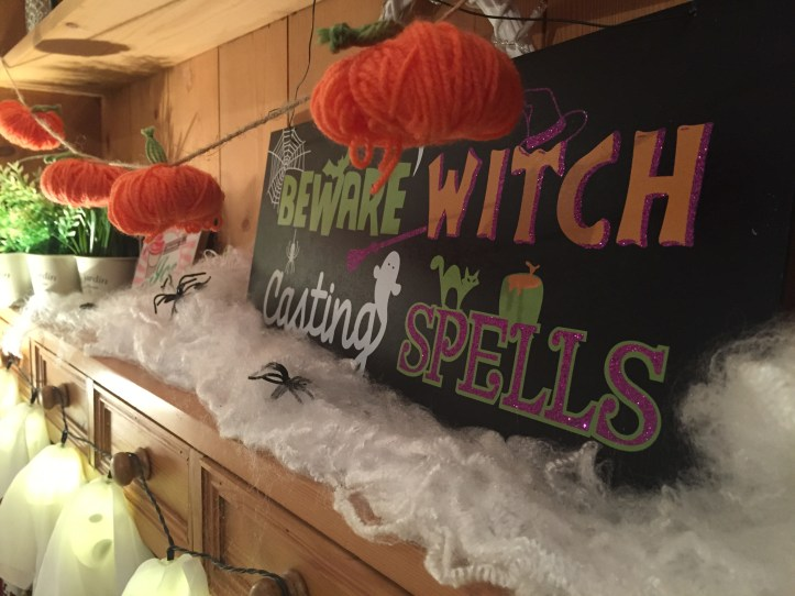 making your home ready for Halloween witches sign on dresser