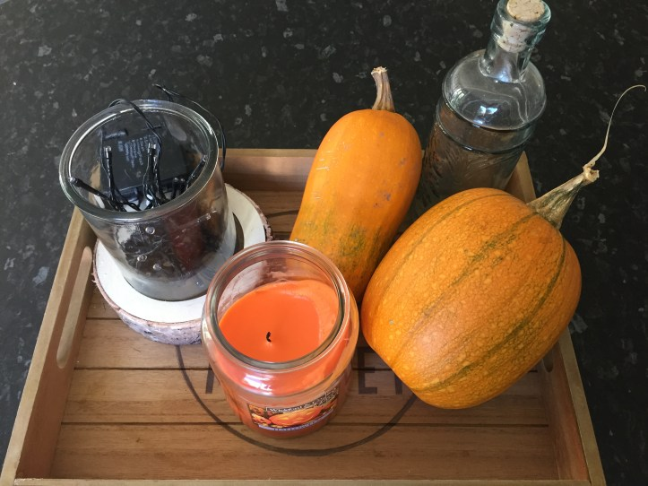 pumpkins ready for halloween with a candle home decor