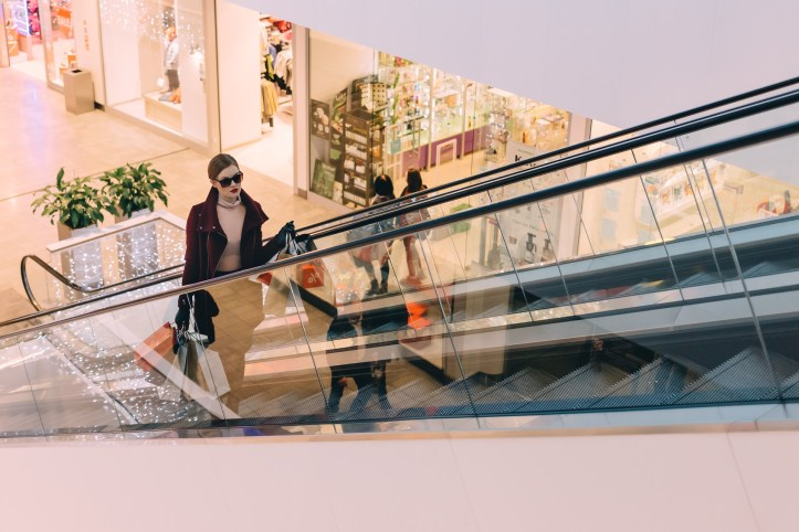 saving money when at shopping mall escalators