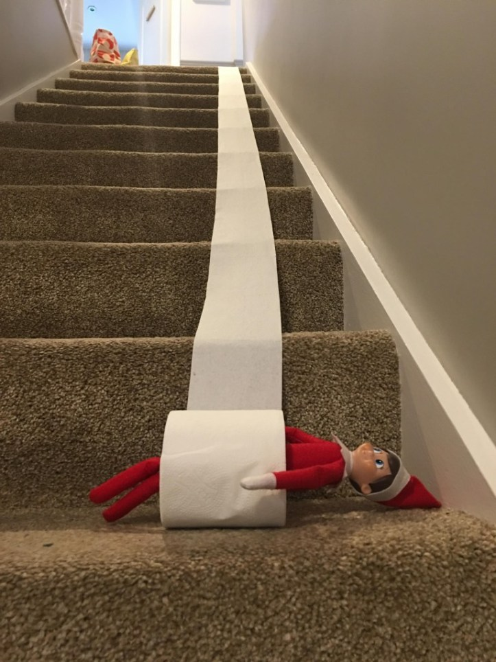 elf on the shelf rolling down the stairs