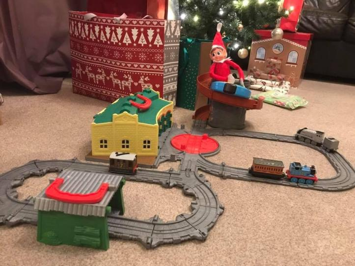 elf on the shelf making a train track