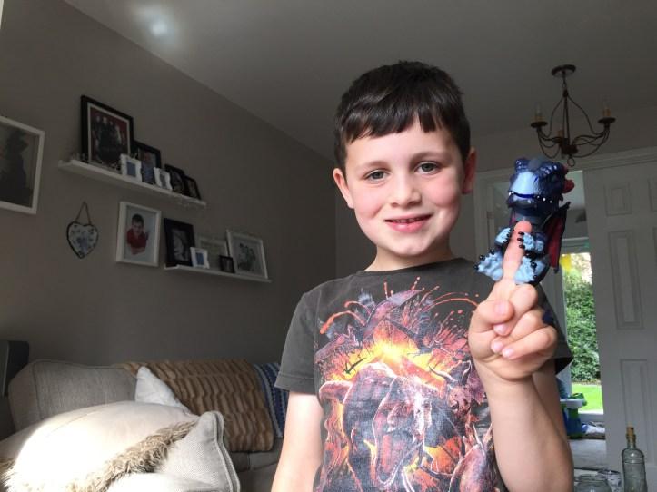 untamed dragon fingerlings toy - boy holding