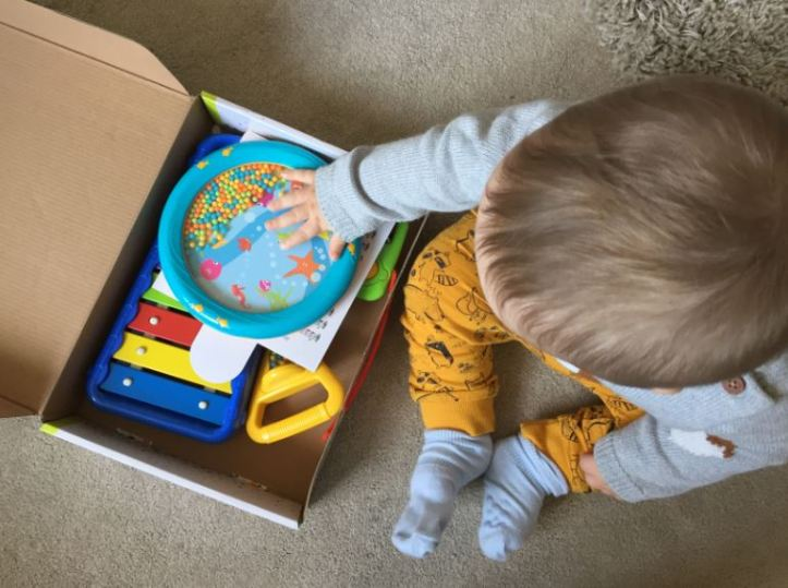 Halilit Toddler Music Orchestra - baby exploring box of musical instrument toys 2
