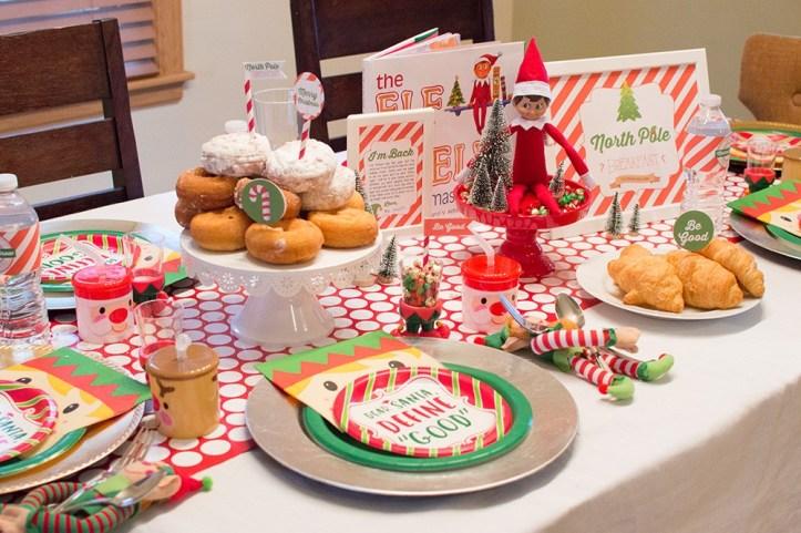elf on the shelf breakfast arrival idea - laid table