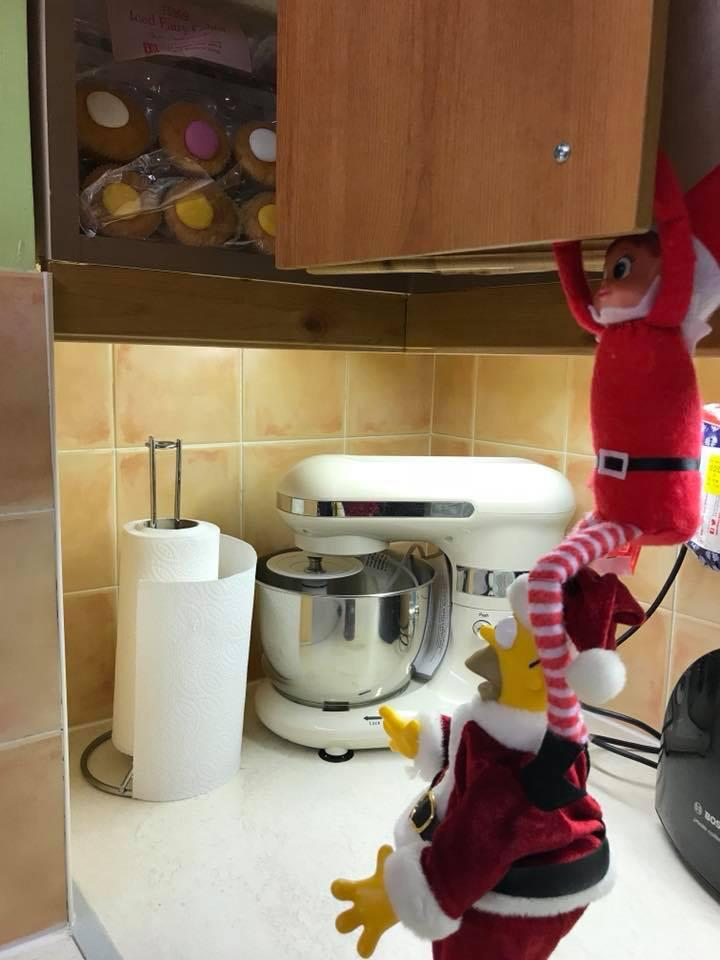 elf on the shelf stealing cakes
