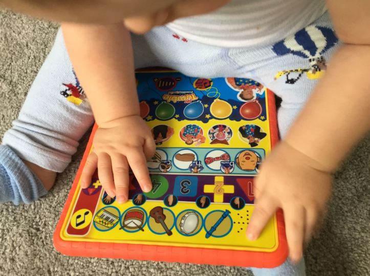 mr tumble something special learning pad - baby playing with buttons