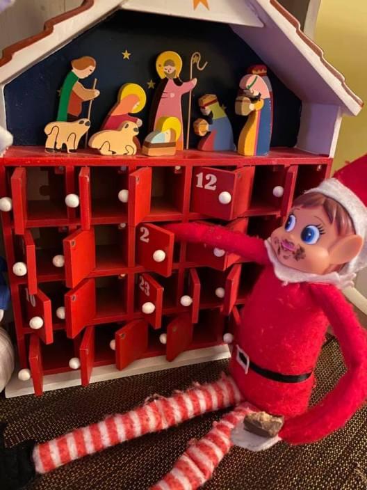 elf on the shelf eating chocolate calendar