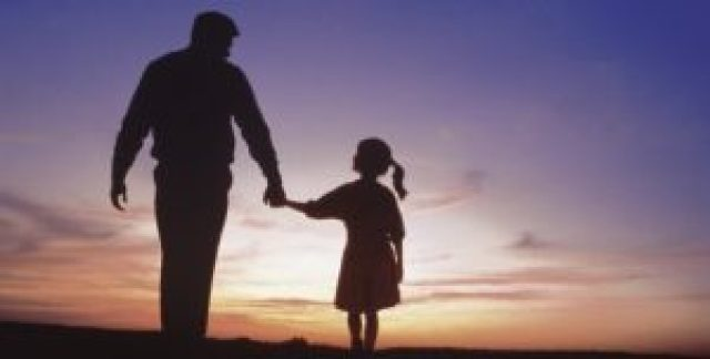 father-and-daughter-walking-at-sunset-494x250