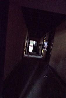Dark Hallway with a Folding Chair