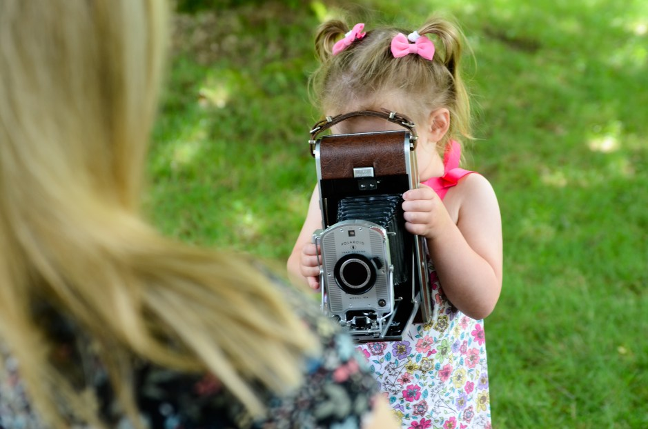 Little girl taking her mom's photo, Babs Mullinax, me and grace, me & grace, Fort Wayne photographer, photo gifts, lifestyle photography, family photos, ideas for family photos, indoor photography, fun family photographer, long-distance family