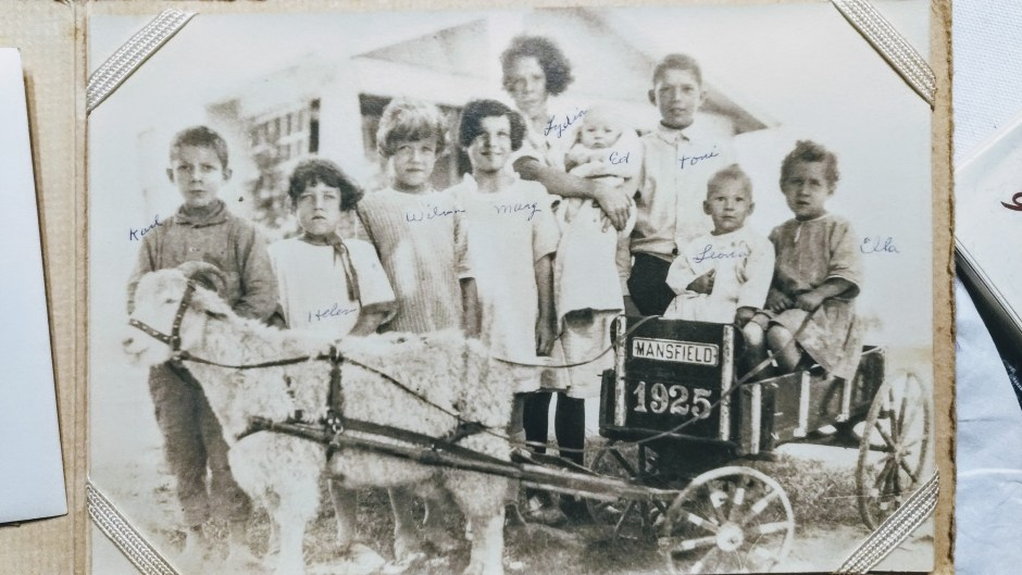 Old black and white photo of children on a wagon, Babs Mullinax, me and grace, me & grace, Fort Wayne photographer, photo gifts, lifestyle photography, family photos, ideas for family photos, indoor photography, fun family photographer, long-distance family
