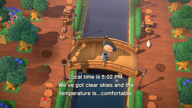 """A person waves """"Local time is 5:02 PM. We've got clear skies and the temperature is... comfortable."""""""