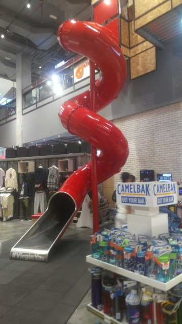 Slide extending up one floor at Virgin