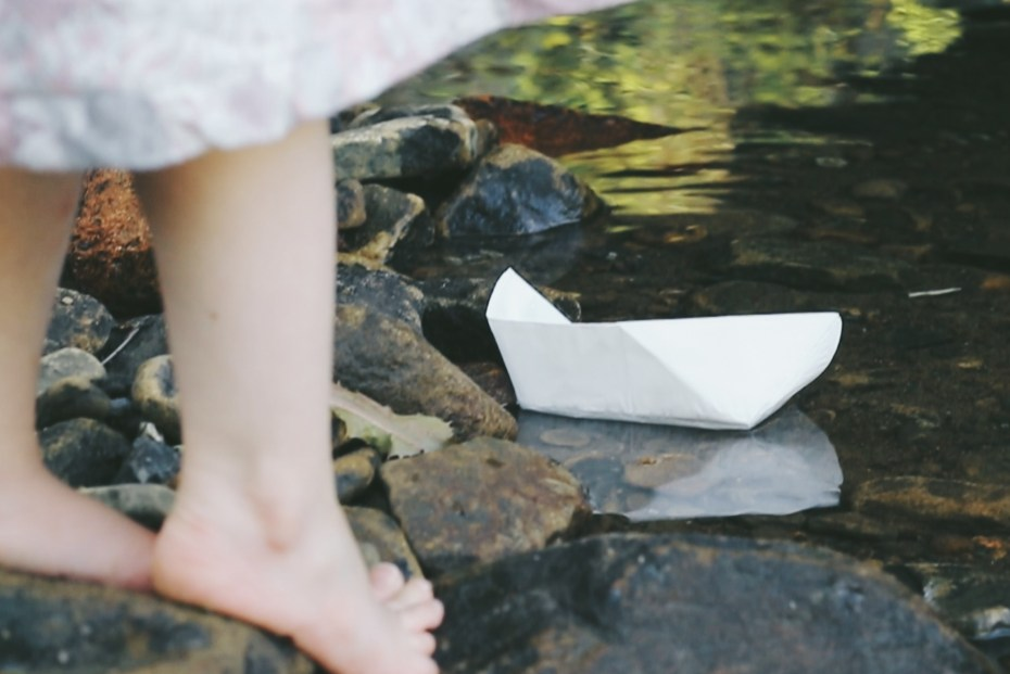 paper boats in stream