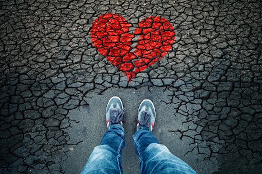 broken heart drawn on cobblestones