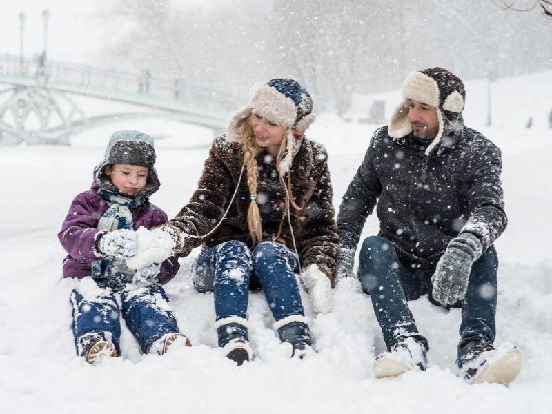 Family Ski trip to Austria, family in the snow.