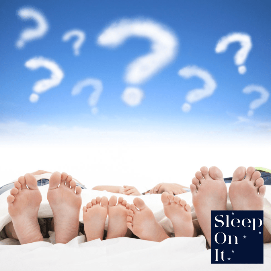 image of peoples feet under blanket with question marks in the sky above