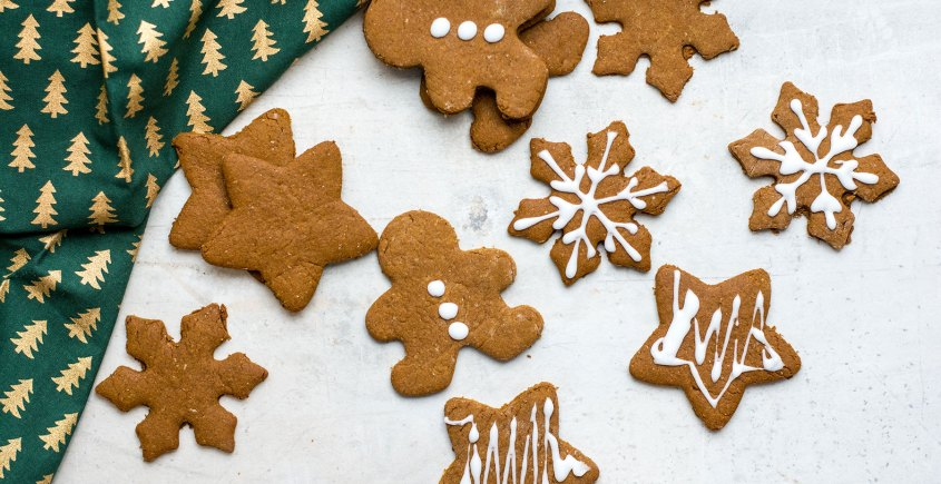 cut out holiday gingerbread cookie shapes on white background