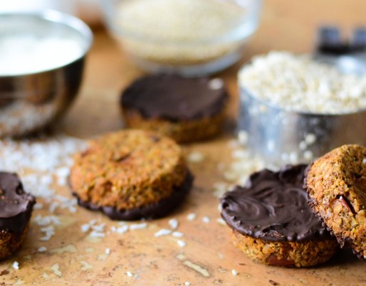 quinoa and chocolate snacks on background with oats