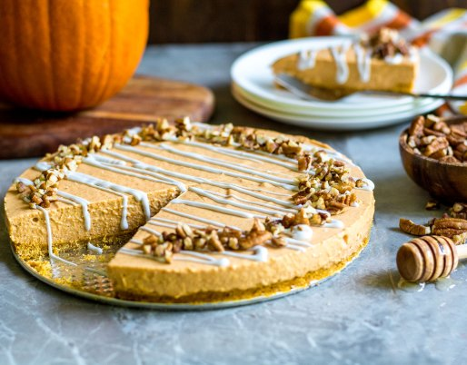 pumpkin cheesecake on table with nuts