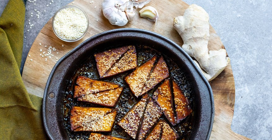 baked tofu in a pan with ginger and garlic