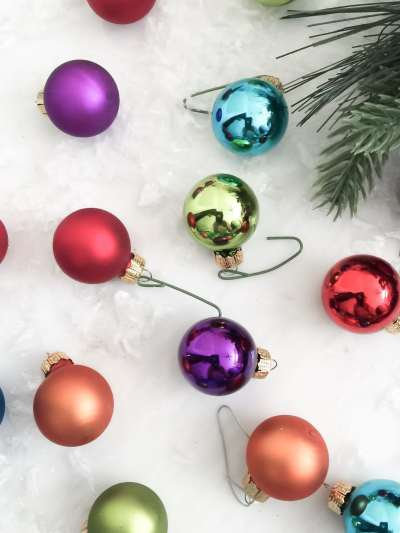 colorful mini christmas balls- decorate tree listening to holiday songs