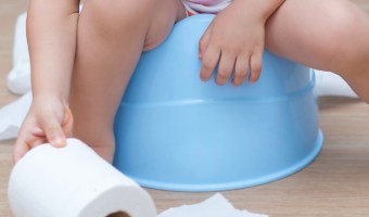child-potty-training-reaching-for-roll-of-toilet-paper