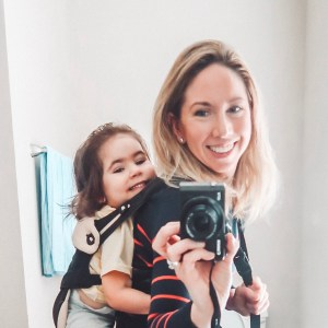 mom-carrying-toddler-girl-on-back-in-ergo-360-baby-carrier