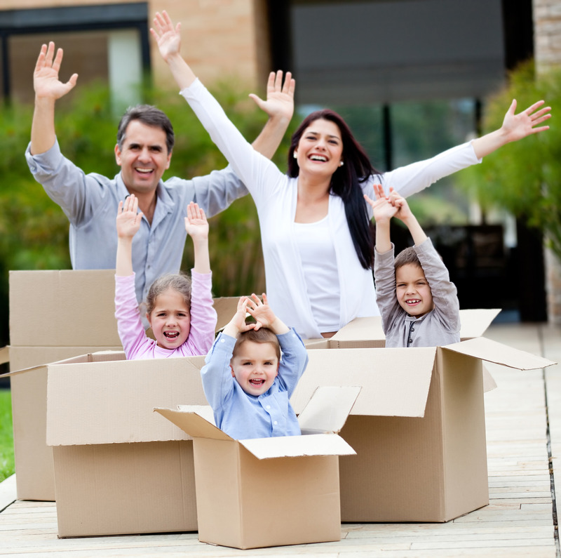 moving-checklist-concept-family-standing-in-moving-boxes