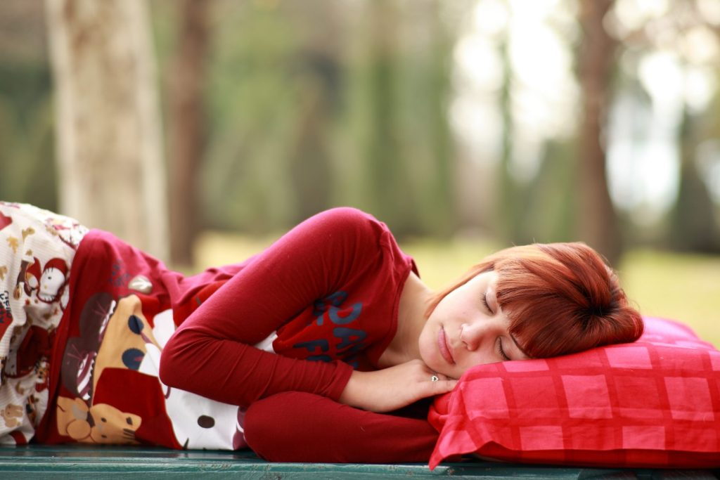 woman-taking-nap-outdoors