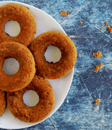 a plate of vegan keto pumpkin spice doughnuts