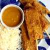 a plate of cauliflower rice and vegan keto tempeh satay with peanut sauce