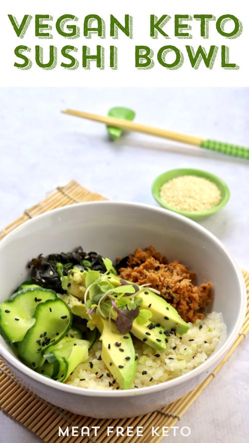 A bowl of vegan sushi ingredients - cucumber, toona, avocado, seaweed salad and sesame seeds