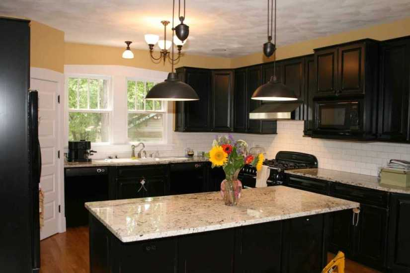 16. Black kitchen cabinet with a modern lighting concept