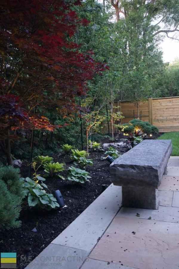 complete-landscaping-project-walkout-basement-firepit-interlocking 13
