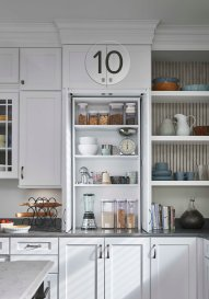 Pocket doors allow easy access to small appliances and help keep like items together.