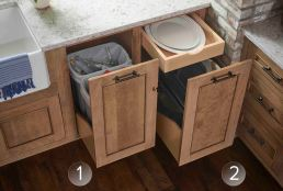 Waste and recycling in a full-height pull out and tiered/tray divider pull-outs make the most of a single cabinet.
