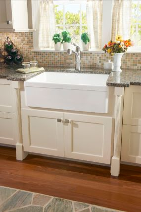 A fireclay apron sink is accented with furniture details of split posts.