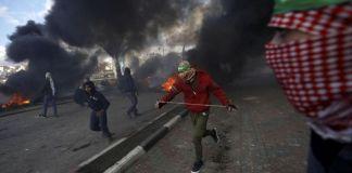Palestina Kecam Langkah Israel untuk Kuasai Tepi Barat Palestina mengecam keputusan partai berkuasa di Israel, Partai Likud untuk menguasai wilayah Tepi Barat. (REUTERS/Mohamad Torokman)