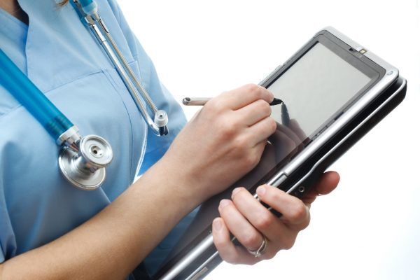 electronic medical record The doctor uses a tablet pc