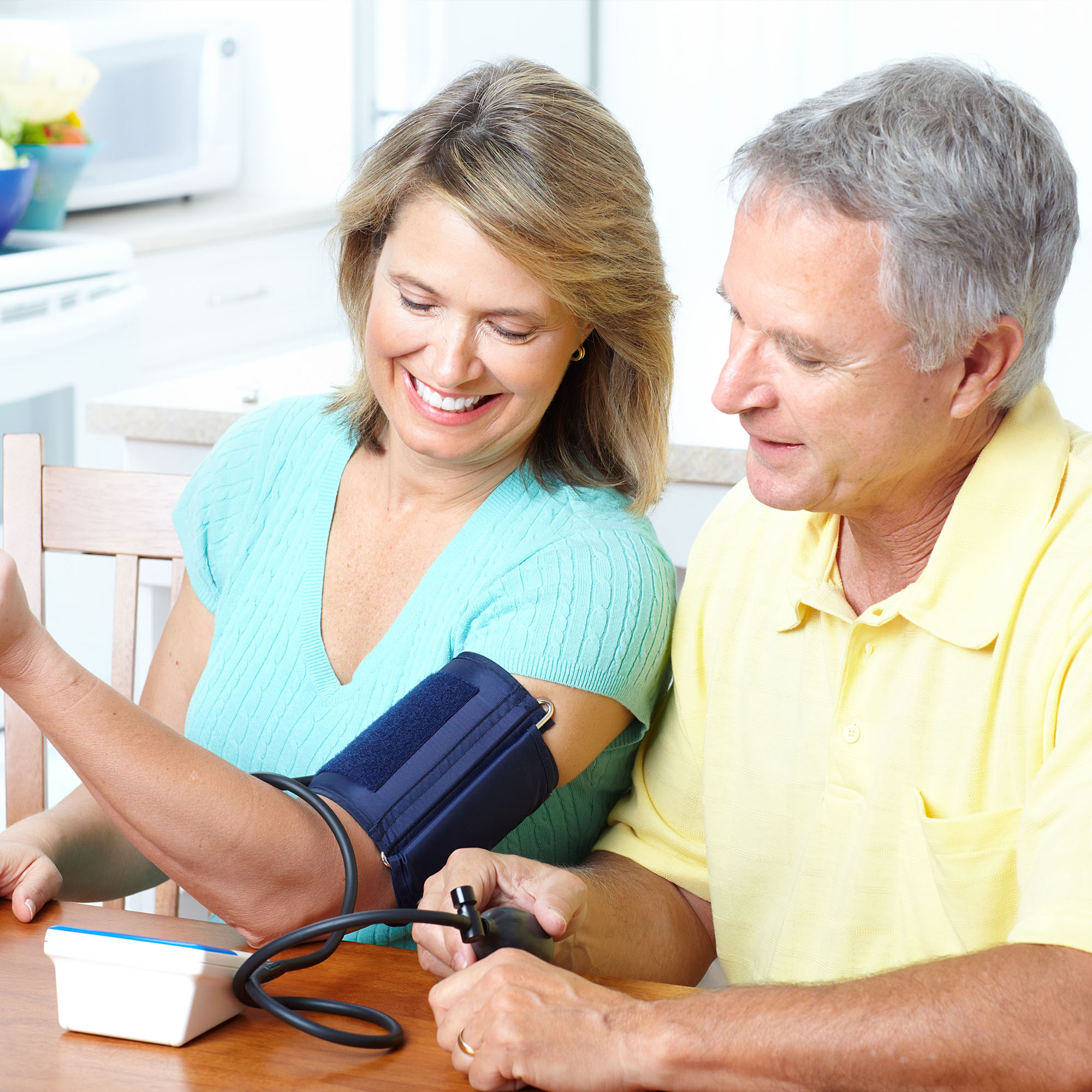 Two patients enjoying the comfort and mobility of a Blood pressure cuff provided by MedekRPM.