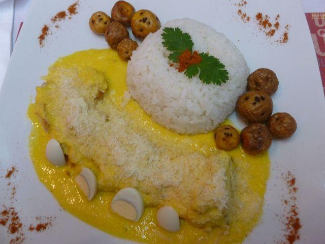 Aji de gallina estilo Peru Mix (chicken with a yellow garlic sauce Peru Mix style).