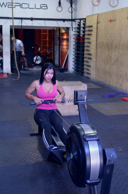 Athelete warming up on the row machine