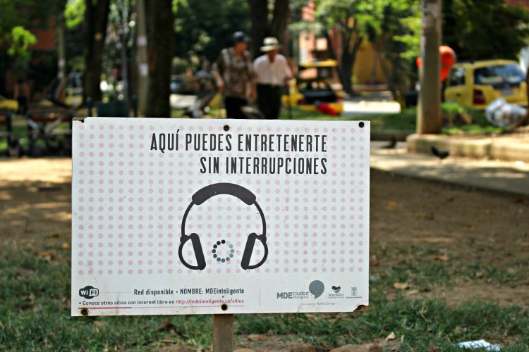 Signs for the public WiFi network provided by Fundación EPM in Parque de La Floresta