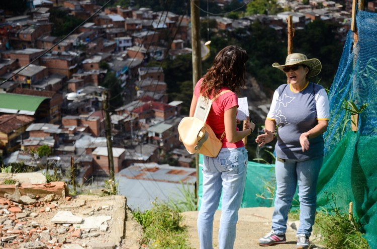 Sara Vallejo from E2E talks with one of the leaders of the JAC, Villa Liliam in La Comuna 8