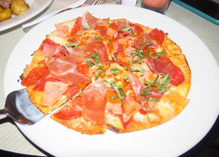 Four meats pizza at Delaire
