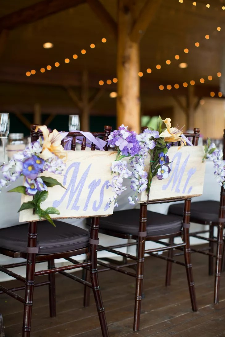 mr and mrs chair signs lift design kalyn dillon hung wooden from their chairs