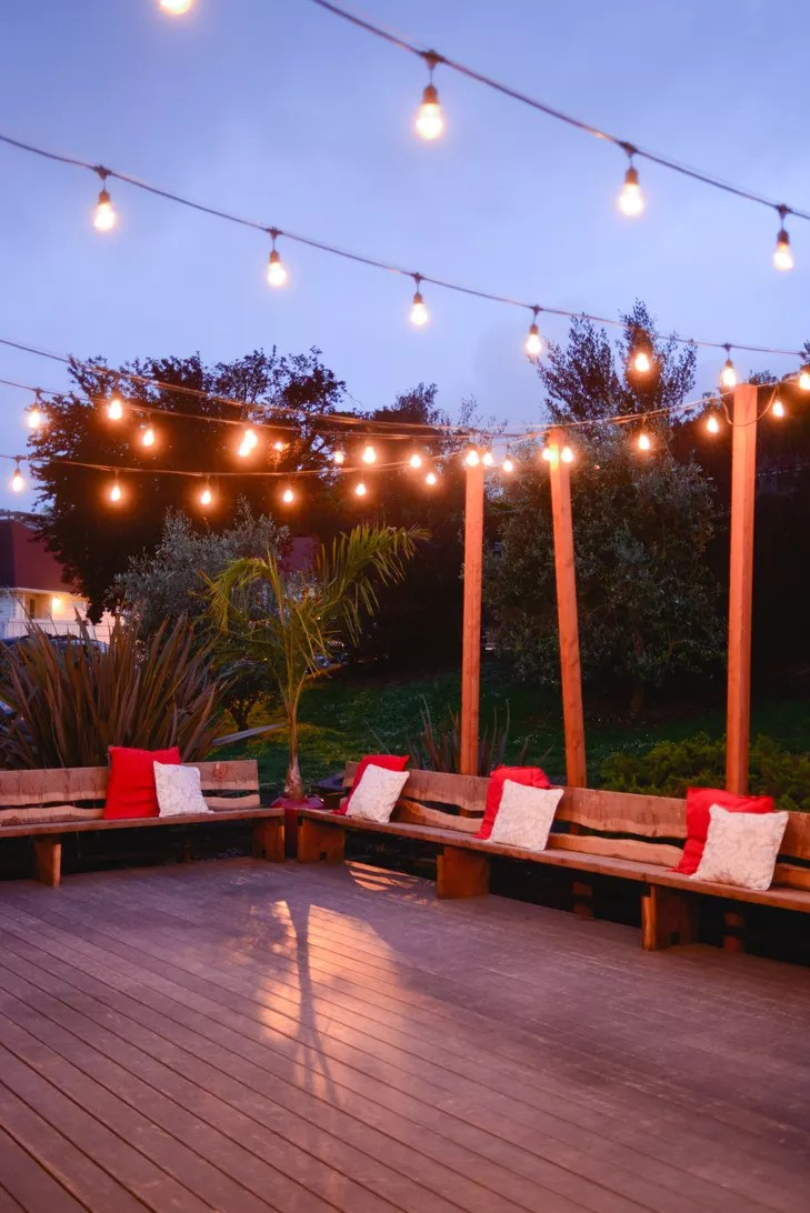 back deck string lights and benches