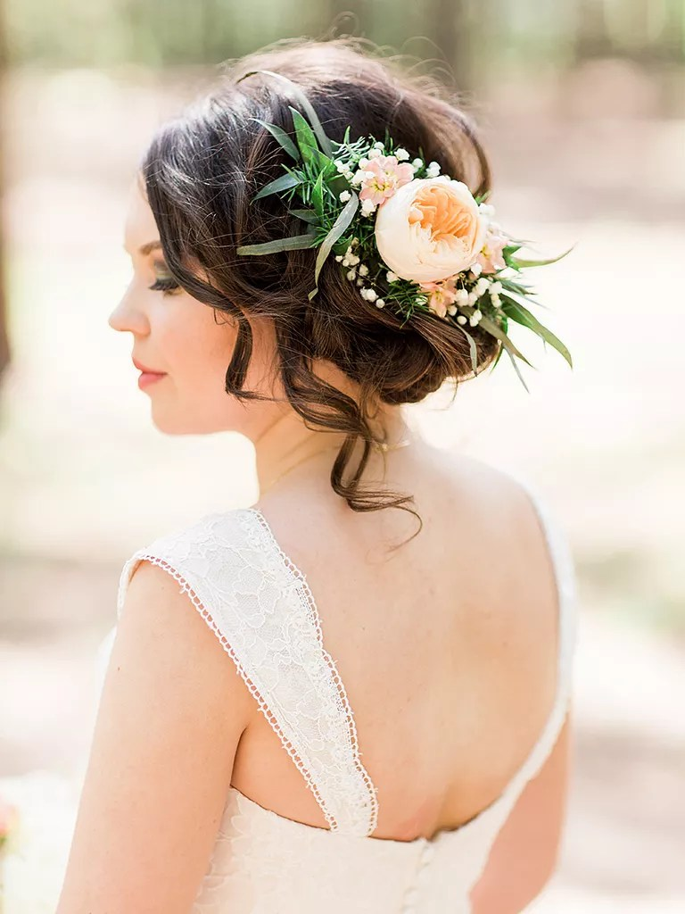messy bun boho wedding hairstyle with flowers